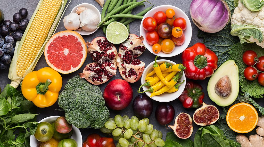 Healthy food panorama background. Assorted fresh ripe fruits and vegetables, top view